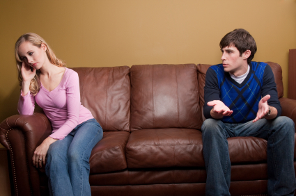 A couple has an argument on the couch